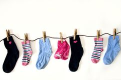 Colored socks of different sizes weigh on ropes royalty free stock photo