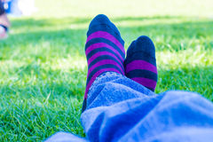 Colored socks of a teenager who is resting in a park Stock Image