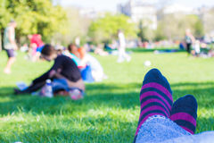 Colored socks of a teenager who is resting in a park Stock Photos