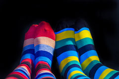 Colored socks on a Valentine couple. Feets Royalty Free Stock Photography