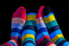 Colored socks on a Valentine couple. Feets Stock Photo