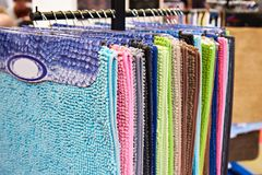 Colored soft bathroom mats in store. Colored soft bathroom mats in the store Stock Image