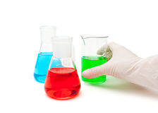 Colored solution in laboratory flasks Stock Photography