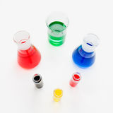 Colored solution in laboratory flasks Stock Photos