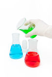 Colored solution in laboratory flasks Royalty Free Stock Photo