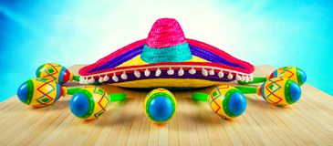 Colored sombrero and maracas on a wooden background. Stock Photography