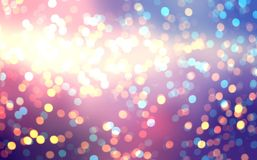 Colored sparks on the evening blurred background. In the light of the setting sun spread golden bokeh. Royalty Free Stock Photography