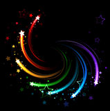 Colored sparks. Glowing sparks of all colors of the rainbow twist on a black background Royalty Free Stock Photos