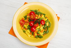 Colored spatzle on yellow dish. Some colored spatzle on yellow dish royalty free stock images