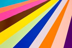Colored speets of paper form a colorful background stock image