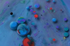 Free Colored Spheres In Turquoise Liquid With Other Colors Stock Images - 164296454
