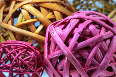 Colored spherical interlaces. Some colored spherical interlaces made of plant material Royalty Free Stock Images