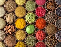 Spices and herbs background. Condiments on the table spread out Royalty Free Stock Photos