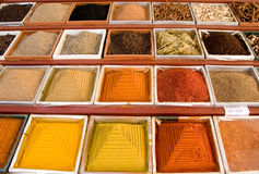 Colored spices. Square small boxes with spices in market Royalty Free Stock Images