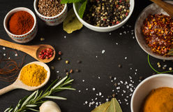 Colored spices  on stone Stock Images