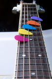 Colored spikes on a mast guitar Royalty Free Stock Image