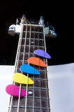Colored spikes on a mast guitar Stock Image