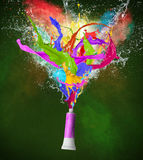 Colored splashes in abstract shape. On black background Stock Illustration
