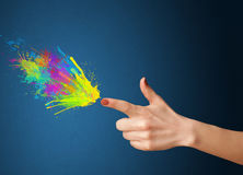 Colored splashes. Are coming out of gun shaped hands Stock Photos