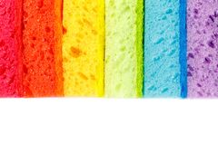 Colored sponges for washing dishes and other domestic needs stock photos