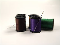 Colored Spools and Needle. Photo of Sewing Spools and Needle stock photos