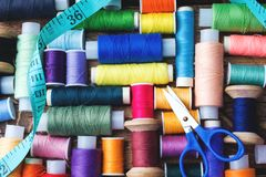 Free Colored Spools Of Thread Laid Out In Rows On Wooden Background Royalty Free Stock Image - 135293226