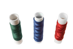 Colored spools of thread. Three colored spools of thread isolated on white Stock Images