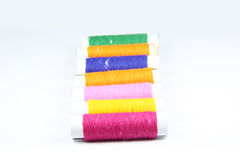 Colored spools of threads Stock Photos