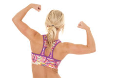 Colored sports bra blond woman back muscles Royalty Free Stock Photo