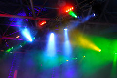 Colored spotlights on ceiling in smoke Royalty Free Stock Photography