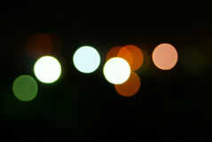 Colored spots. Black background with colored spots Royalty Free Stock Images