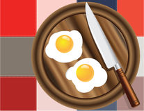 Colored squares and fried eggs Stock Images