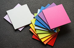 Colored squares. Square plate of bright colors on a dark background Stock Photos