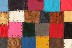 Colored squares. Colored tiles made ​​of leather, compound with each others royalty free stock photos