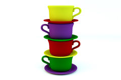 Colored stacked coffee frosted cups. And saucer on white background Stock Image