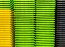 Colored stacked plastic boxes. Colored stacked new plastic boxes stock photo