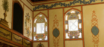 Colored stained glass windows in the Sofa Hall in Khan`s palace. Stock Image