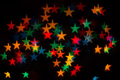 Colored stars. Background of colored stars, shaped bokeh Royalty Free Stock Photography