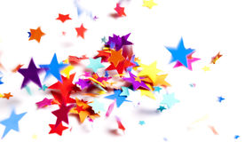 Colored stars confetti. Falling on white Royalty Free Stock Images