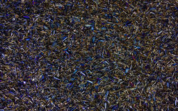 Colored Steel Chips. Steel mashining chips with surface hardening discoloration Royalty Free Stock Photo
