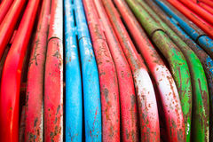 Colored steel tubing. Close up of colored steel tubing used at construction site royalty free stock photography