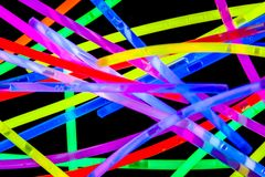 Colored stick lights on black background Royalty Free Stock Photos