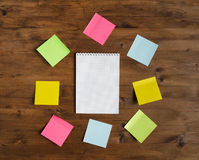 Colored stickers around paper sheet Royalty Free Stock Images