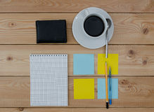 Colored stickers cup of coffee pen notebook and wallet Stock Image