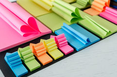 Colored sticky notes. Having different shapes Stock Images