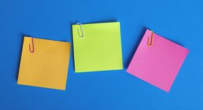 Colored sticky papers royalty free stock photos