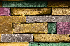 Colored stone blacks. In a wall Royalty Free Stock Photos