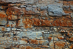 Colored stone texture with cracks Stock Photography