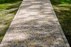Colored stone walkway in a shady park.  Royalty Free Stock Photography