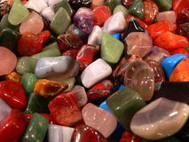 Colored stones. Fund composed of colored and polished stones Stock Photography